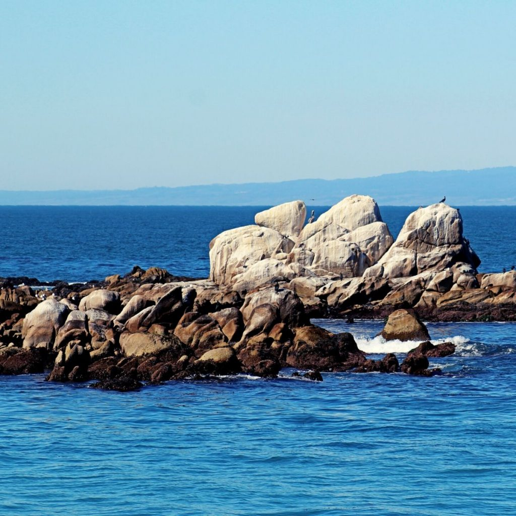California coastal rocks and water and blue sky