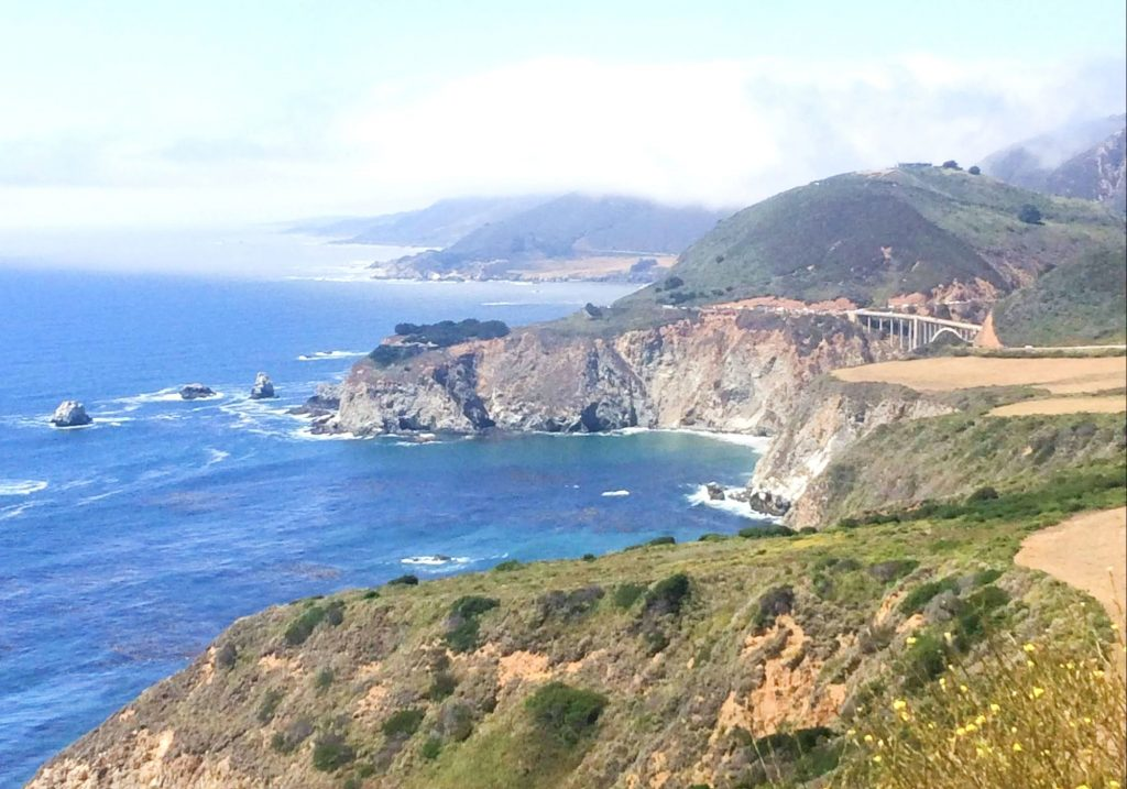 view of ocean cliffs and Bixby Bridge on Carmel to Big Sur day trip