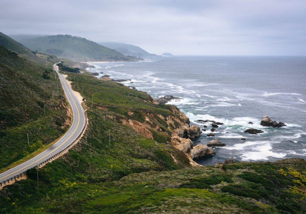 View of ocean cliffs and road on Big Sur day trip from Carmel