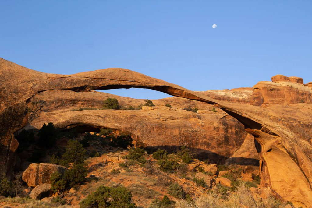 Landscape arch with a small moon in the right top corner