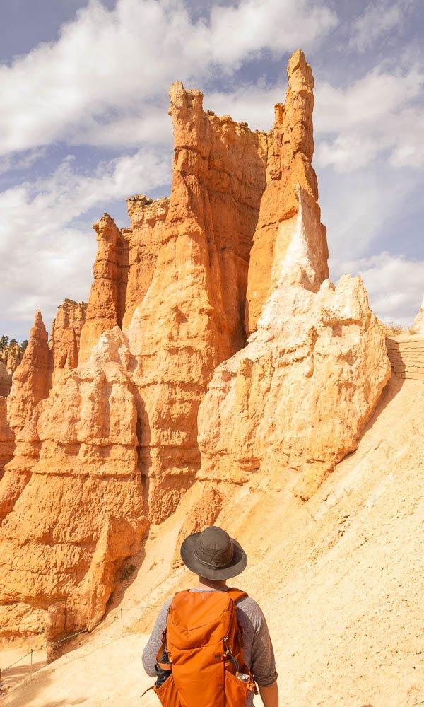 hiker looking up at hoodoos at Bryce Canyon