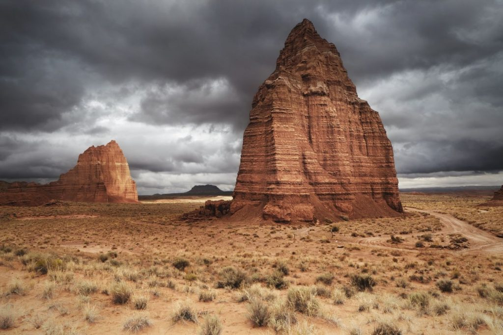Temple of the Sun and Temple of the Moon with a cloudy sky at Capitol Reef National Park